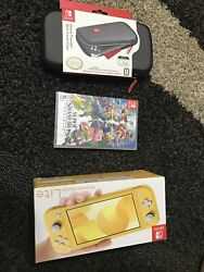 Nintendo Switch Lite Bundle And Super Smash Bros Game And Case - Yellow Console. New