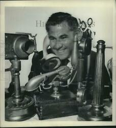 1963 Press Photo George Levine with variety of his antique phones New York