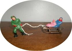 Invc807 You Are Bidding On A Man Pulling Children On Sled Barclay /manoil