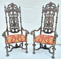 Pair Of Spanish Renaissance Revival Style Carved Throne High Back Arm Chairs