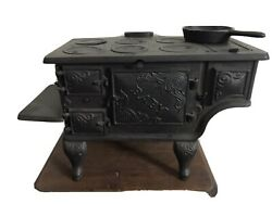 """Antique Miniature Cast Iron Stove Marked """"baby"""""""