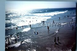 FOUND COLOR PHOTO H0187 VIEW OF PEOPLE PLAYING IN OCEAN