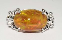 $10000 10.47CT NATURAL ETHIOPIAN OPAL & FANCY ORANGE PINK & WHITE DIAMOND RING