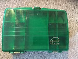 Pre Owned. Plano Tackle Box. 12.5 X 8.5 X 4. Green And Tan. Slightly Scratched.