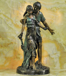 Bronze statues of a couple
