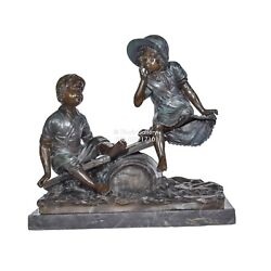 Bronze Statues Chidren playing on a seesaw