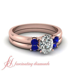 3/4 Ct Oval Shape Diamond And Blue Sapphire Trilogy Engagement Rings Set For Women