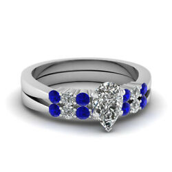 1 Carat Pear Shaped Diamond And Blue Sapphire Tapered Edged Style Bridal Rings Set