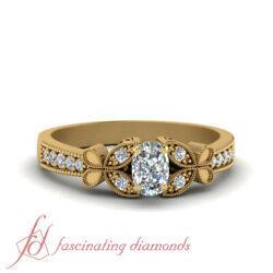 Half Carat Cushion Cut Diamond Vintage Butterfly Engagement Ring In Yellow Gold