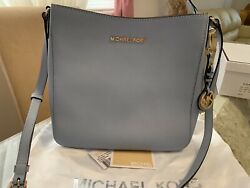 Authentic Michael Kors Jet Set Travel Crossbody Bag pre owned with dust bag $120.00