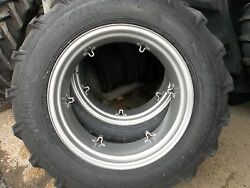 Two 13.6x2813.6-28 Ford Tractor 8 Ply Tractor Tires With 6 Loop Wheels