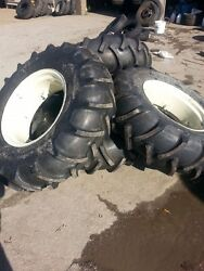 Four 14.9x24 John Deere Ford 8 Ply Tubeless Easy Repair Tractor Tires On Wheels
