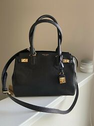Designer Bag by Henri Bendel in perfect condition. Black Leather w brass accents $180.00
