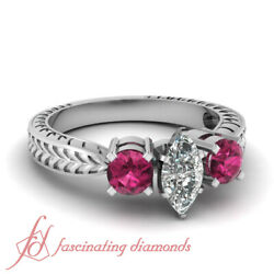 Three Stone Engagement Ring 1.30 Tcw. Marquise Cut Diamond And Round Pink Sapphire