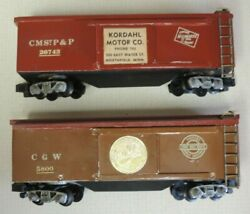2 Vintage Pressed Metal Box Cars Cmstp And P 26743 And Cgw 5800 American Flyer