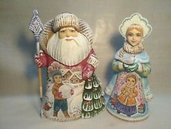 Handmade Collectible Carved Figures Of Santa Claus And Snow Maiden. 23 Cm