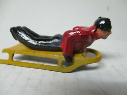 Vintage Barclay Cast Metal Christmas Garden Scene Red Coat Man Laying On Sled