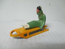 Vintage Barclay Cast Metal Christmas Garden Scene - Man In Green On Yellow Sled