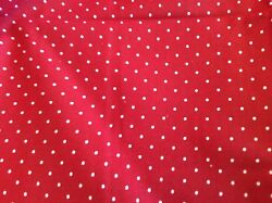 MARCUS BROS. WHITE PIN DOTS ON RED BY FAYE BURGOS- 1 YARD