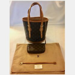 LOUIS VUITTON MONOGRAM PETIT BUCKET BAG WITH POUCH. VERY GOOD CONDITION.