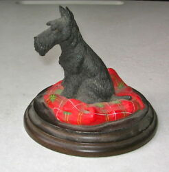SCOTTISH TERRIER  SITTING ON A PILLOW MOUNTED ON A WOOD BASE