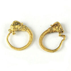 A fine pair of early Ptolemaic pair of gold earrings with gazelle terminals y841