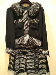 Louis Vuitton (Very Rare) Suit- Jacket and Skirt.