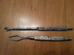 Two Button hooks with Flowered Design Handles