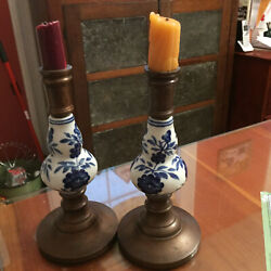 A Pair Of Delphi Porcelain And Bronze Candlestick Holders