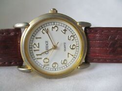Carriage By Timex Analog Wristwatch Wtih Quartz Movement And A Buckle Band