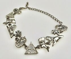 Silver Tone Egyptian Charm Bracelet With A Variety Of Charms