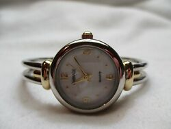 Carriage By Timex Wristwatch Silver And Gold Two Toned Round White Face Elegant