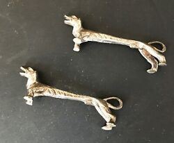 Roberts And Dore Ltd A Pair Of Elizabeth Ii Hallmarked Silver Cutlery Rests.