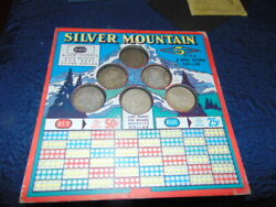 Rare Vintage Silver Mountain Punch Board Stimulator W 6 Silver Dollars Unpunched