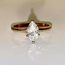 14k 2-tone 6 Prong 3 Engagement Ring. Set With Marquise Cut Diamond.