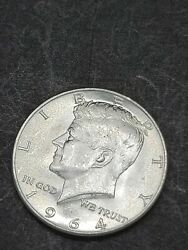 1964  Kennedy  Half Dollar 90 Silver Coin.  Fresh Out The Paper Roll.