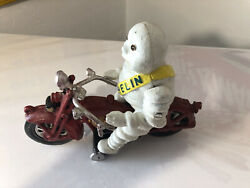 Michelin Man On Red Motorcycle Cast Iron Toy