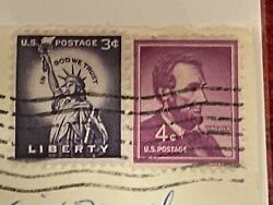 4 Cent Red Lincoln Postage Stamp And A Purple Liberty 3 Cent Postage Stamp, 1962