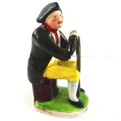 Antique 18th Century Porcelain Figure Of A Seated Man In Tricorn Hat