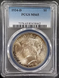 1934 D Silver Peace Dollar Graded Ms 65 By Pcgs Nicely Toned Sku 8462