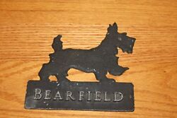 Metal Bearfield sign with Scottish Terrier on top