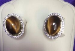 Oval Cabochon Tiger Eye And White Diamonds Halo Earrings In 14k White Gold.