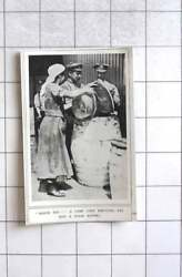 1917 A Woman Camp Cook Emptying Fat Into A Stock Barrel