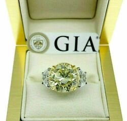 GIA Certified 6.11 Ct. Natural Fancy Light Yellow Round Diamond Platinum18 Ring