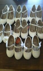 girl's shoes white colors different sizes and designs. $9.99