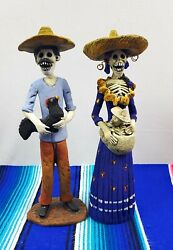 Catrina And Catrin Set Of 2 Hand Made And Painted Out Of Terracotta Clay