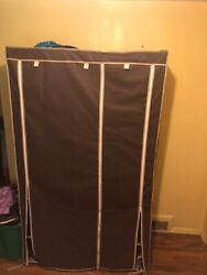 Zip Up Wardrobe Closet with shelves has small dent.