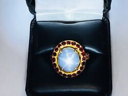10.56 Ct Star Sapphire Certificate With 18kt Gold And Rubies Bezel