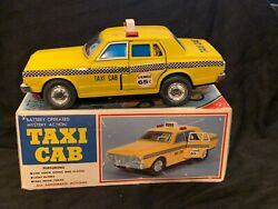 1970's Japanese Yonezawa Tin Lithographed Taxi Cab With Battery Operated Mystery