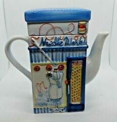 Needle Works Teapot With A Form On The Front And Needles And Spool